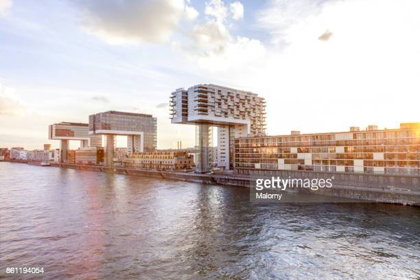 crane houses at river rhine - cologne, north rhine-westphalia, germany - cologne stock pictures, royalty-free photos & images