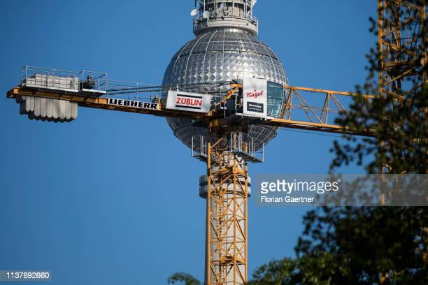 A crane is pictured in front of the Berlin TV Tower on April 17 2019 in Berlin Germany
