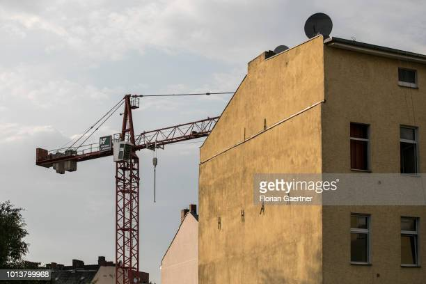 A crane is pictured next to a residential property on August 08 2018 in Berlin Germany