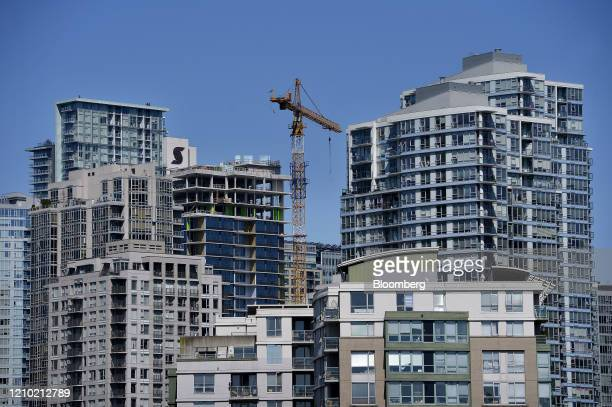 A crane is seen between residential buildings in Vancouver British Columbia Canada on Thursday April 16 2020 As its oil sector shriveled in recent...
