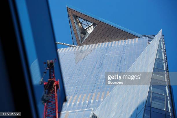 A crane is seen reflected in a window below the Edge observation deck at 30 Hudson Yards in New York US on Thursday Oct 24 2019 Edge is scheduled to...