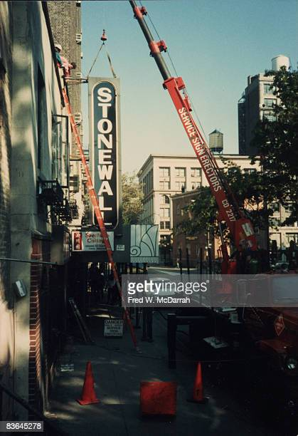 A crane is used to remove the sign from outside the Stonewall bar New York New York October 11 1989 The original Stonewall Inn in the same location...
