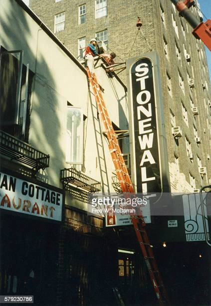 A crane is used to remove the sign from outside the Stonewall Inn New York New York October 11 1989 The original Stonewall Inn in the same location...