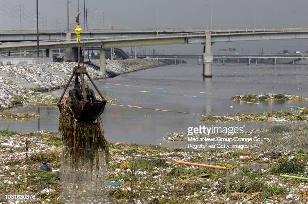 Crane lift trash and debris from the mouth of the Los Angeles river in Long Beach, CA on November 26, 2008. Floating booms at the mouth of the river...