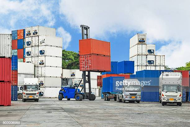 CONTENT] Crane lifter handling container box loading to truck in import export logustic zone