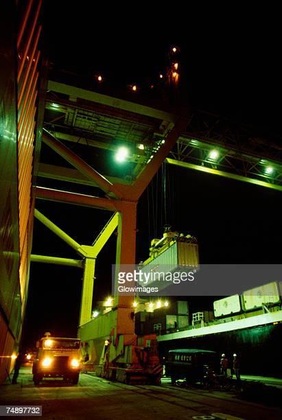 Crane lifting a container at marine terminal, Hong Kong, China