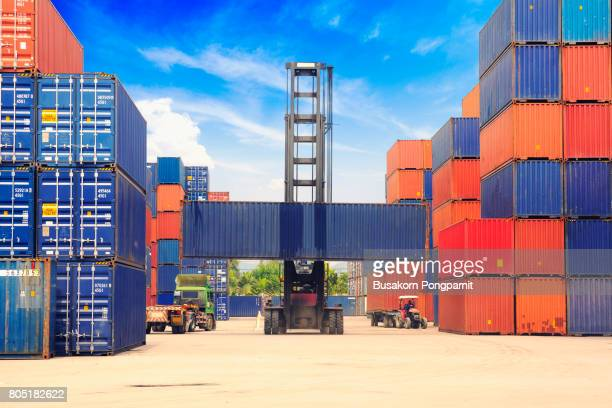 crane lifting up container in yard, control loading containers box from cargo freight ship - behållare bildbanksfoton och bilder