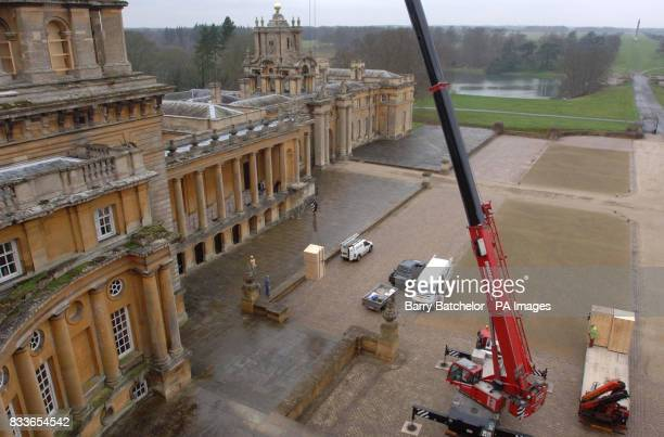 A crane lifts a boxed statue onto Blenheim Palace's North Facade