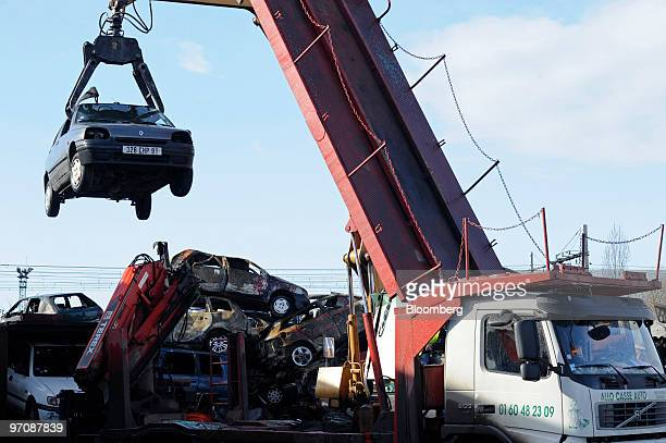 A crane lifts a car at Allo Casse Auto's car demolition site in Athis Mons France on Wednesday Feb 24 2010 French consumer spending declined in...