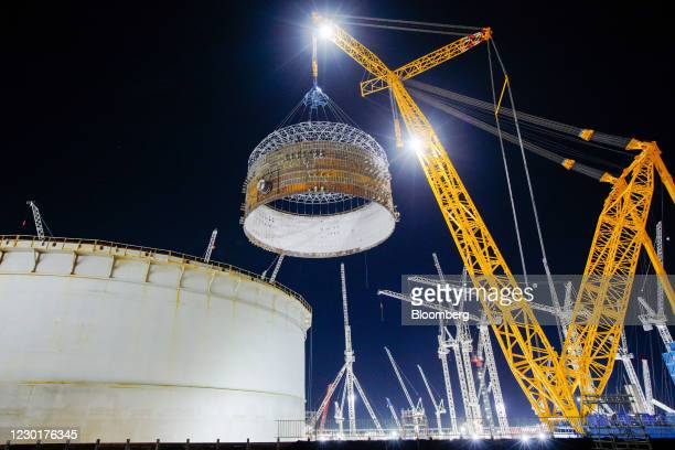 Crane lifts a prefabricated steel containment ring into position at the nuclear Reactor Unit 1, at Hinkley Point C nuclear power station construction...
