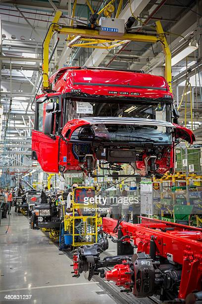 A crane lifts a truck cabin onto its chassis on the assembly line inside the Scania AB plant in Sodertalje Sweden on Wednesday March 26 2014...