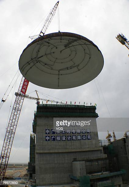 A crane lifts the dome of Ling'ao Nuclear Power Station into position on September 23 2007 in Shenzhen south China's Guangdong province