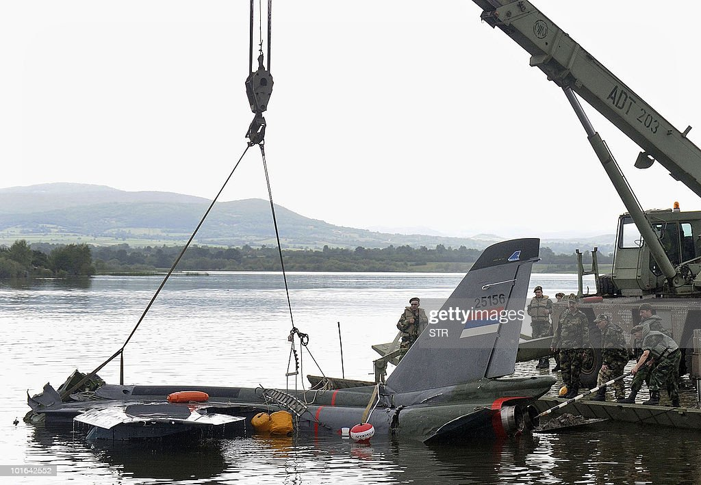 A crane lifts the wreckage of the Soko Orao (Eagle) combat aircraft, crashed into a lake, on June 5, 2010 near the central Serbian town of Kragujevac. A Serbian air force plane crashed in a lake in central Serbia on June 3, 2010, but the pilot managed to eject.