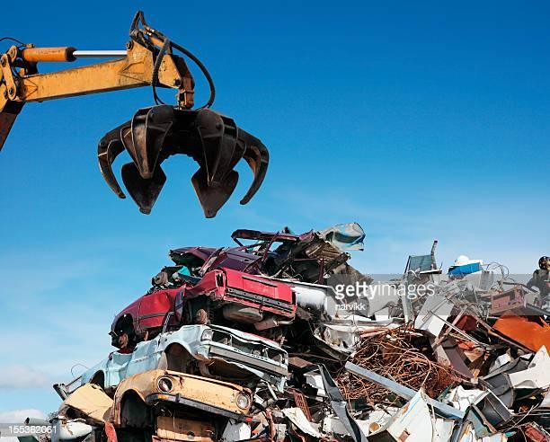 crane loader taking scrap iron - junkyard stock photos and pictures