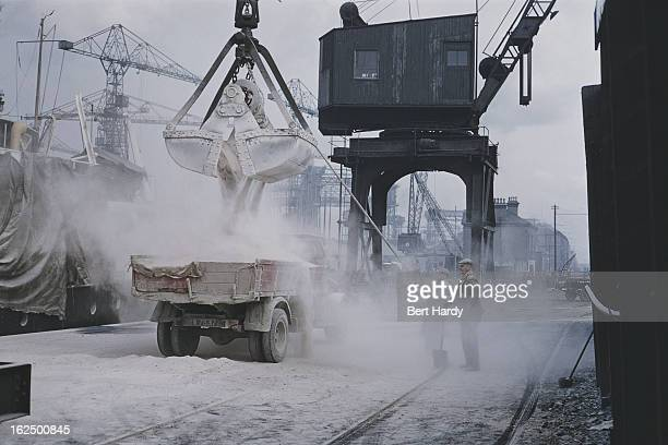 A crane loading a truck on the quayside at the Harland Wolff shipyard in Belfast Northern Ireland June 1955 Original publication Picture Post 7825...