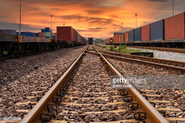 crane loading container box to logistics truck for exports in container port - rail transportation stock pictures, royalty-free photos & images