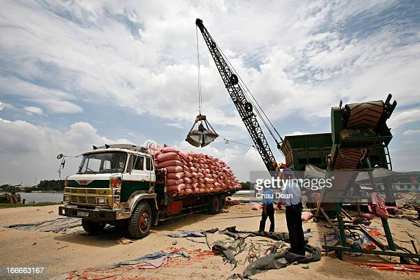 A crane loads material from boats up to a truck at GreenFeed Co Ltd in Ben Luc Long An Vietnam GreenFeed is a fast growing Vietnambased aquafeed...
