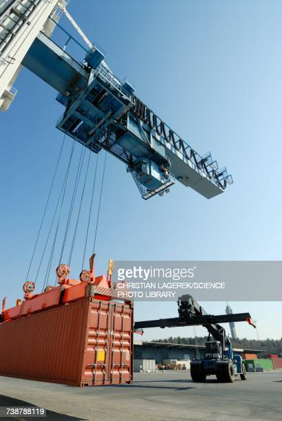 Crane lowering shipping container