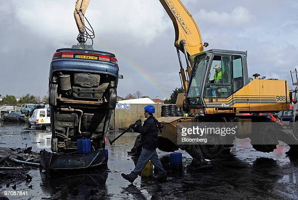 A crane moves a damaged car at Allo Casse Auto's car demolition site in Athis Mons France on Wednesday Feb 24 2010 French consumer spending declined...