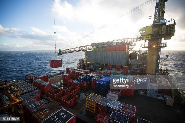 A crane moves freight on the weather deck of the Armada gas condensate platform operated by BG Group Plc in the North Sea off the coast of Aberdeen...
