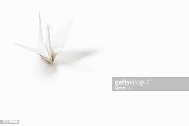 Crane of white paper folding