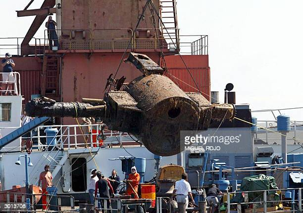 A crane on a barge pulls up the submerged upper part of the Admiral Graf Spee's rangefinder sunk in the River Plate during WW2 off the coast of...