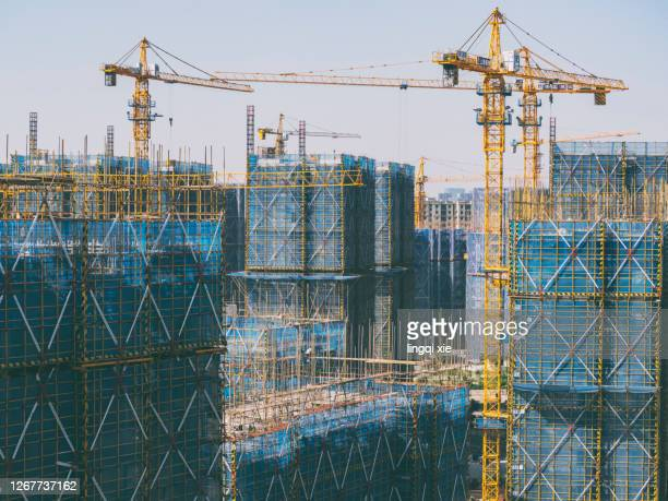 crane on a new residential area construction site - transport stock pictures, royalty-free photos & images
