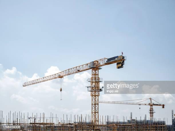 crane on a new residential area construction site - 吊り上げる ストックフォトと画像
