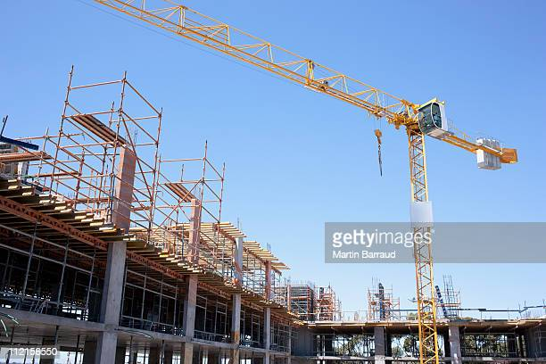 crane on construction site - crane stock pictures, royalty-free photos & images