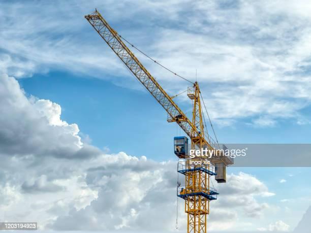 crane on construction site - クレーン ストックフォトと画像
