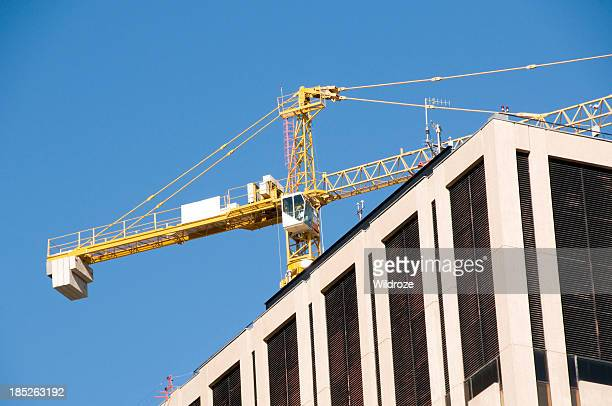 Crane on top of highrises
