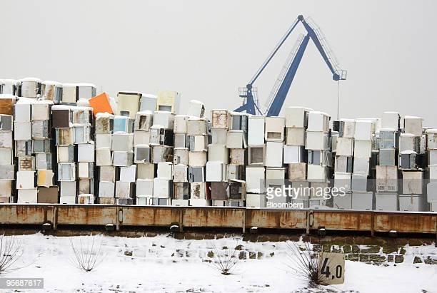 Crane operates behind a row of discarded refrigerators to be used as scrap metal in Duisburg, Germany, on Monday, Jan. 11, 2010. Germany's...