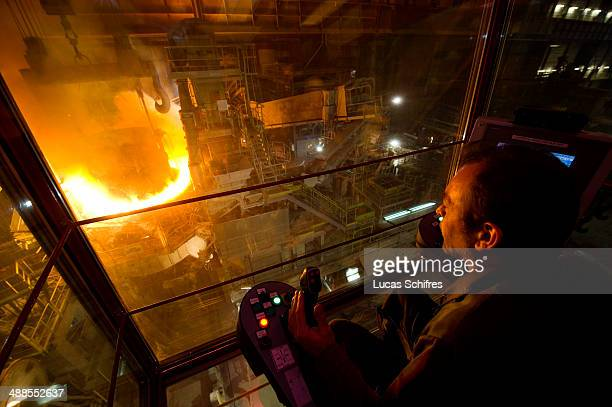 Crane operator Bruno Delmer operates a KoneCranes brige crane to carry steel in a giant tank to the electric arc furnace for melting in Vallourec...