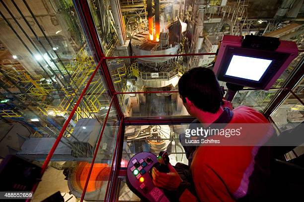 Crane operator Christophe Debreuilly operates a KoneCranes brige crane in order to carry melted steel in a giant tank in Vallourec steel mill factory...