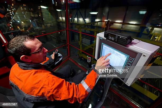 Crane operator Lionel Cartignies operates a KoneCranes brige crane using a touchscreen in Vallourec steel mill factory on November 28 in Saint Saulve...