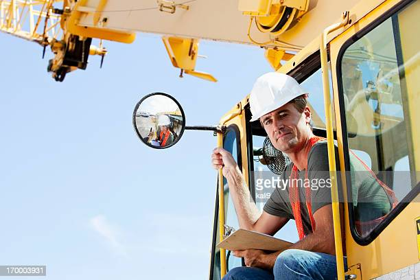 crane operator - crane construction machinery stock pictures, royalty-free photos & images