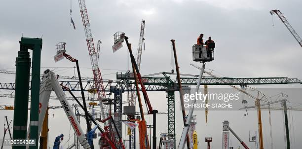 Crane operators display its workings at the crane stand at the openair exhibition area of the world's largest construction trade fair the Bauma 2019...