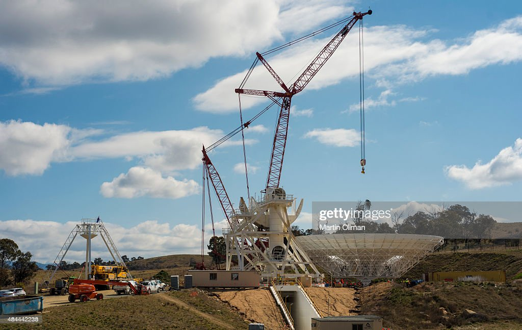 A crane prepares to lift a new 34m antenna at the Canberra Deep