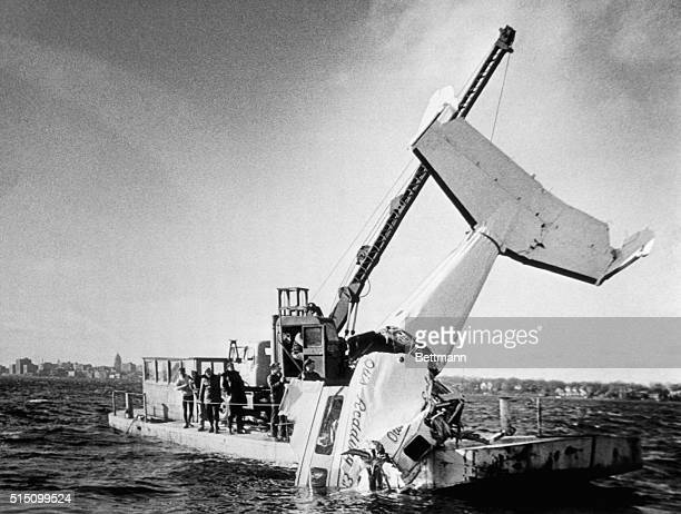 A crane pulls the wreckage of Otis Redding's Beechcraft H18 out of Lake Monona Redding and four of his band members were killed when his plane...