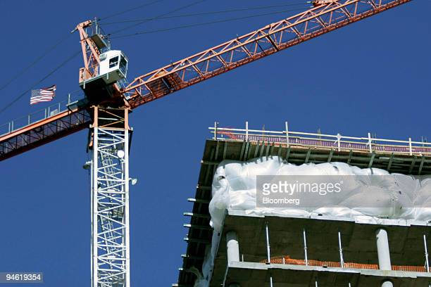 A crane rises over the Waterview building on North Lynn Street near the Key Bridge in Arlington Virginia December 8 2006 The top floor of the...