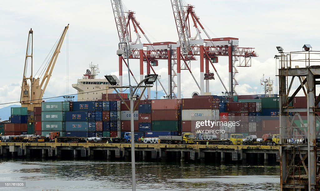 A crane stacks shipping containers of Philippine products