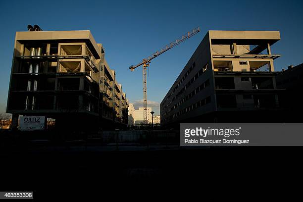 A crane stands at a construction site on February 12 2015 in Alcorcon near Madrid Spain Spain's residential property sales rose during 2014 for the...