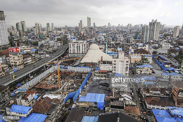 A crane stands during phase one of construction on the Bhendi Bazaar redevelopment project managed by the Saifee Burhani Upliftment Trust a charity...