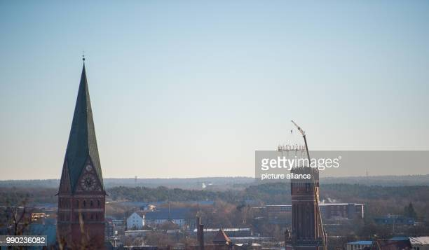 Crane takes down the so-called Wichern wreath from the 56-metre-high water tower in Lueneburg, Germany, 08 January 2018. The aluminium wreath is one...