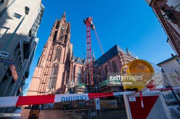 A crane that had damaged the roof of the Frankfurter Dom cathedral following high winds from storm Sabine pictured on February 10 2020 in Frankfurt...