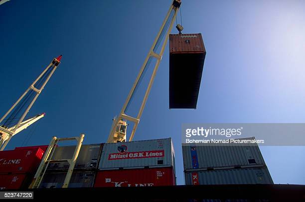 Crane Unloading Cargo Containers From Ship