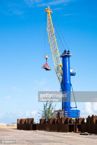 crane used for lifting cargo, on the dock side in the united arab emirates, middle east. - claire plumridge stock pictures, royalty-free photos & images