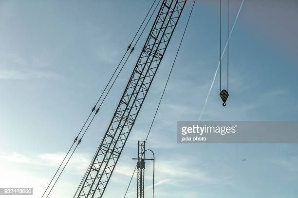 crane with cables and hook - 滑車 ストックフォトと画像