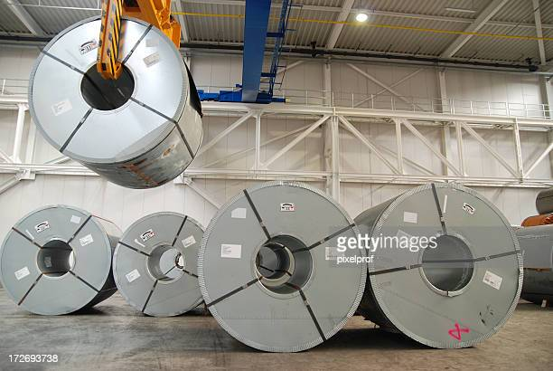 crane with rolls of sheet steel - spiral stock pictures, royalty-free photos & images