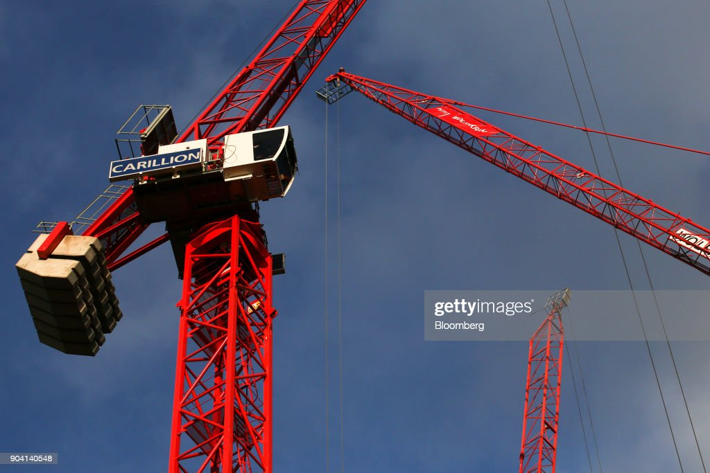 A crane, with the logo of building contractor Carillion Plc, stands on a construction site in London, U.K., on Wednesday, Jan. 10, 2018. U.K. ministers are said to have met over the possible demise of Carillion, according to the Financial Times, without saying where it got information. Photographer: Luke MacGregor/Bloomberg via Getty Images